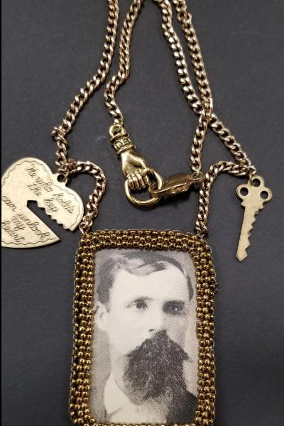 Bearded Man with Heart and Key Necklace