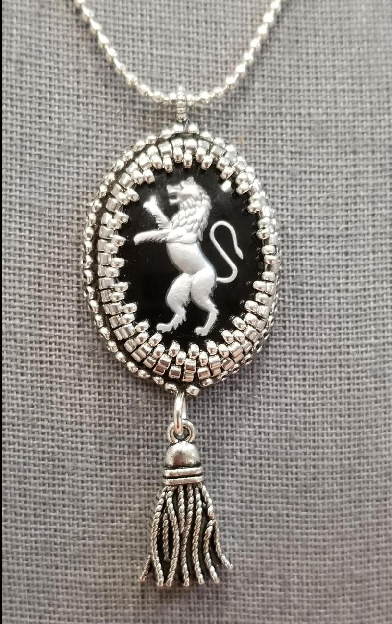 Beaded Lion Crest and Silver Tassle Charm Pendant